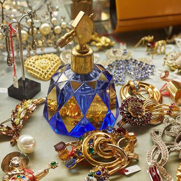 vintage blue glass perfume bottle and collection of costume jewellery
