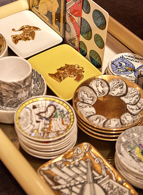 a selection of plates by designer Piero Fornasetti
