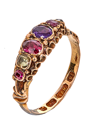 a antique ring in gold with ruby stones